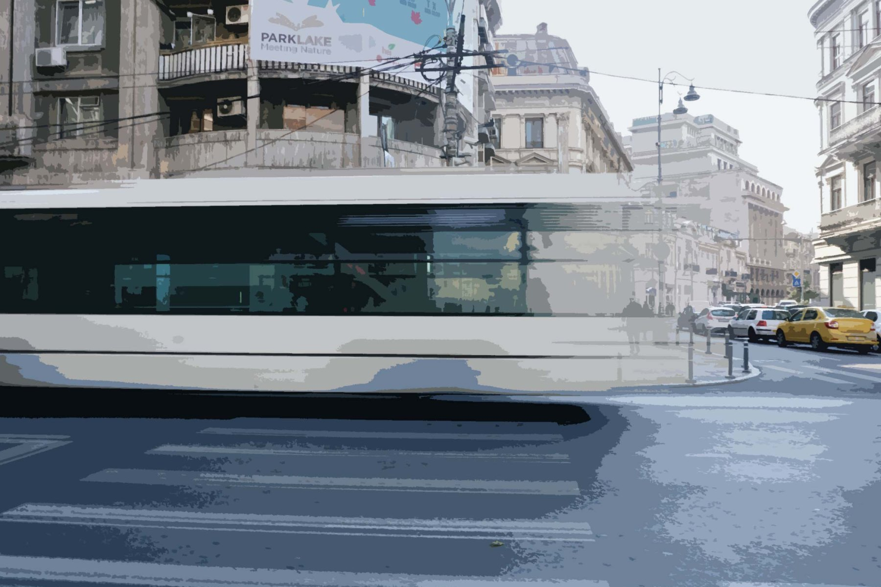 Image of Bucharest, Romania. A large white bus drives past in a whirl and large buildings are in the background. The street in the foreground are empty, and one man looks transparent and diminutive in the background